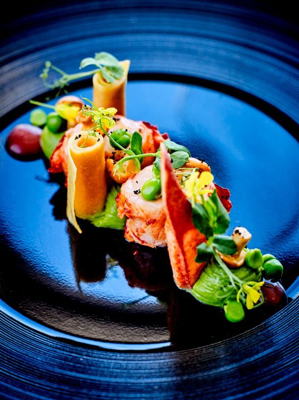 Roasted Blue Lobster, green peas, tarragon flavoured grapefruit @Jean-Claud Amiel