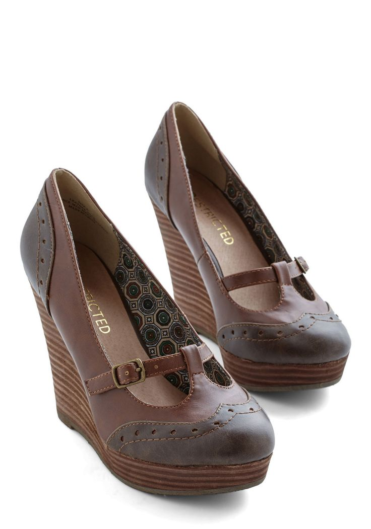 Strive for Something New Wedge. Two trustworthy designs combine to make these distinct two-toned Oxford wedges by Restricted. #brown #modcloth