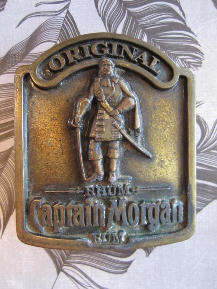 Original Captain Morgan's Rum Brass Belt Buckle  70s. $34.00, via Etsy.