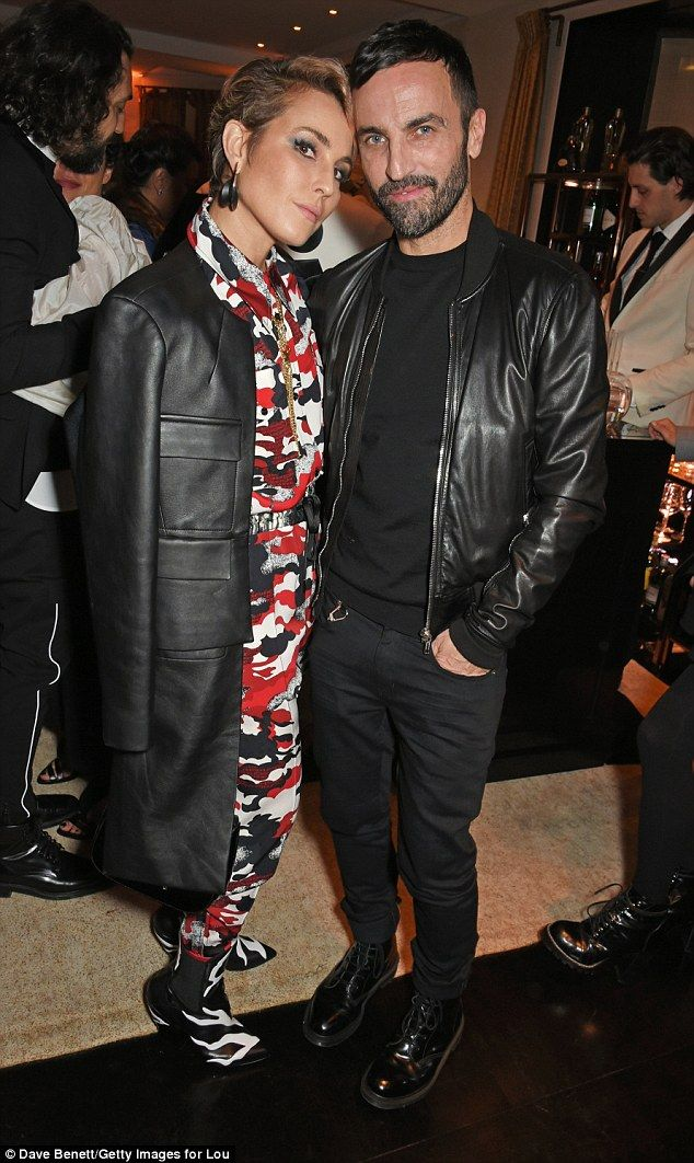 Directional: Actress Noomi Rapace certainly stood out in a camouflage jumpsuit...