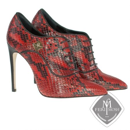 FERI MOSH - Allegra Oxford - Stilettos  Price                                  $2,826 Canadian Dollars Product #                           FMLS-5311 Product Category              FERI MOSH Opulence Wear - Red genuine python oxford stiletto heels  - Made with genuine python uppers and lined with nappa leather and suede  - Real leather sole  - Quality stacked wood heel  - Metal plate with FERI MOSH logo on the outer side of both shoes - Lace up, oxford design  - FERI MOSH logo embossed inside…