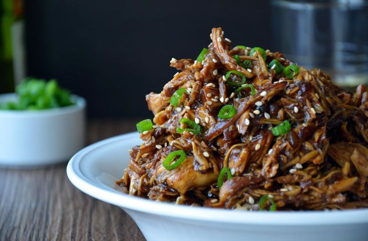 This slow cooker chicken recipe stars tender shredded chicken breasts tossed in a sweet and tangy Asian-inspired sauce.