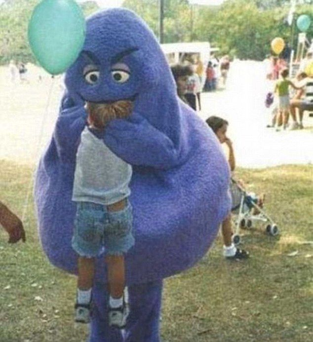 Monster munch: A man in a weird-looking costume appears to take a bite out of a child's head