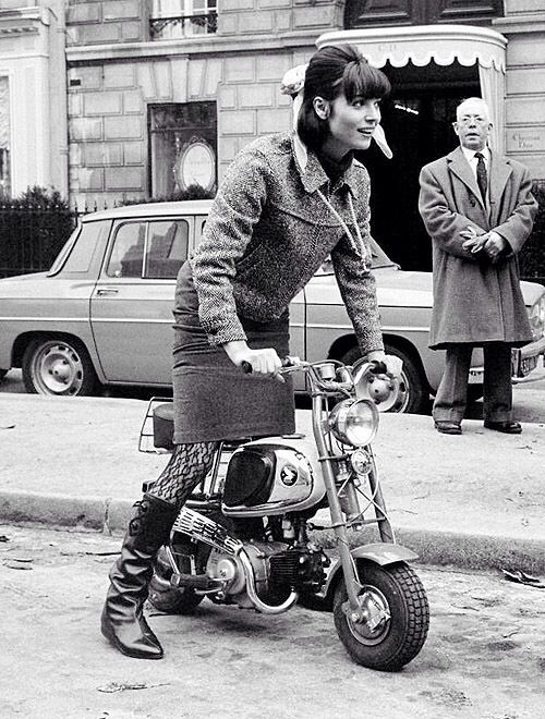 60s woman in suit on a Honda minibike