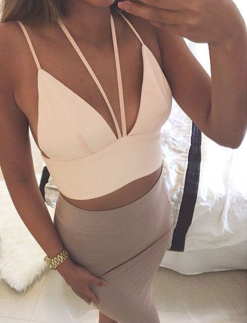 I like the idea of this outfit--I like the details on the top and the overall crop top paired with a high waisted skirt.