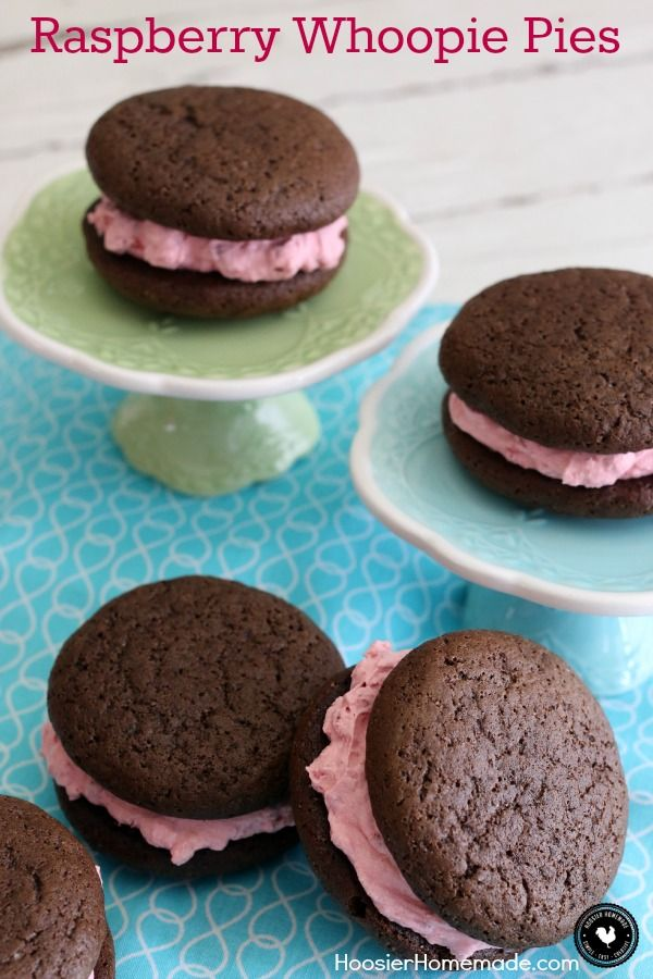 Raspberry Whoopie Pies - fluffy raspberry filling sandwiched between 2 chocolate cookies! Be sure to save room! You won't want to miss this one! Pin to your Recipe Board!