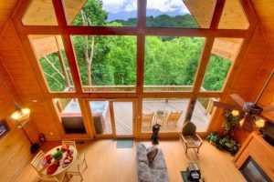 The living room and deck of the Majestic View cabin in Gatlinburg.