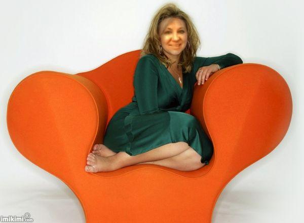 On the orange armchair