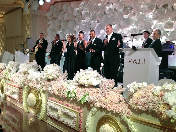 A Beautiful Four Seasons Wedding | Paper flower backdrops and custom-made stage | Revelry Event Design