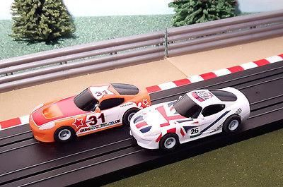 For sale Micro Scalextric ... One careful owner! Browse here http://www.actionslotracing.co.uk/products/micro-scalextric-pair-1-64-cars-orange-gummygums-31-white-bill-richards-26?utm_campaign=social_autopilot&utm_source=pin&utm_medium=pin