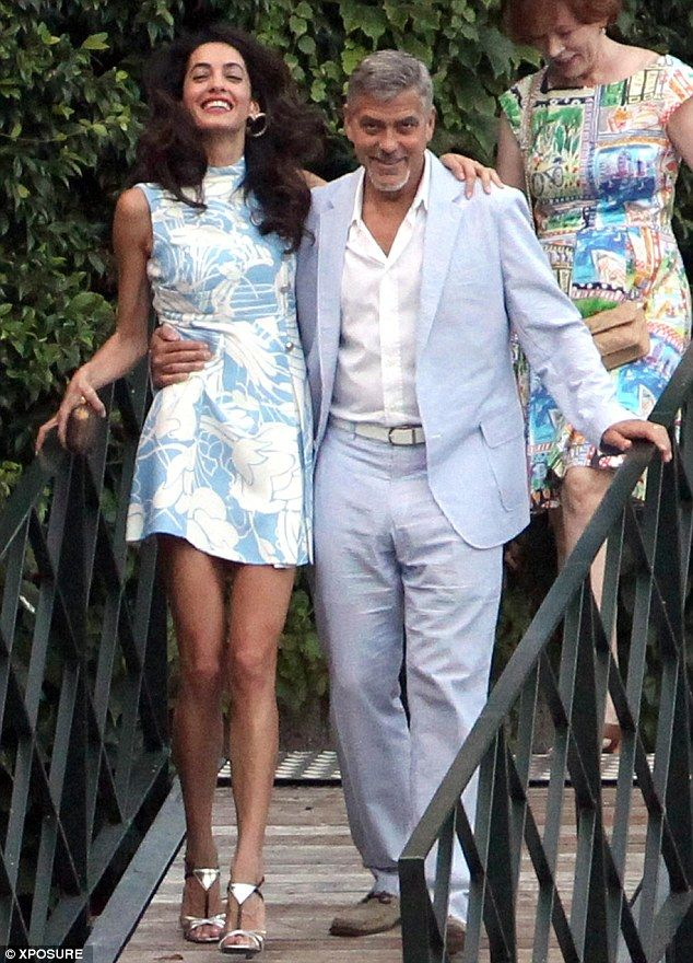 Helping hand! George Clooney and his wife Amal Alamuddin get close after heading back to Lake Como in Italy, ten months after they wed in lavish Venetian ceremony