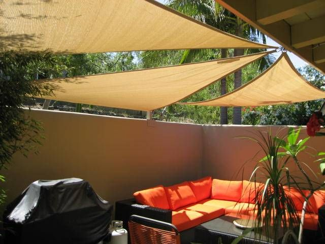 shade sail idea for back yard--the material could be attached to posts...