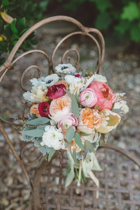 The bouquet recipe: garden roses, coral peony, ranunculus, anemones, scabiosa pods, French tulips, dusty miller, seeded eucalyptus
