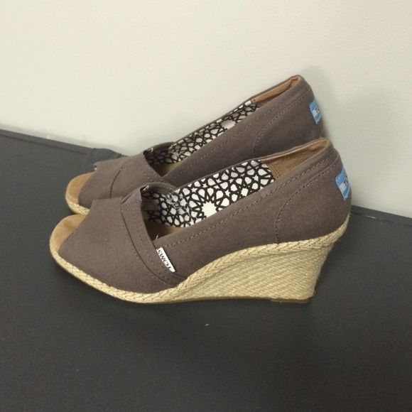 Like new Toms wedges Only worn around the house. Size 8.5 Toms wedges TOMS Shoes Wedges