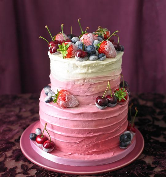This beautiful pink tower of cake and fresh berries comes from bespoke cake designer Charlotte White and her new book Deliciously Decorated. Classic Victoria sponge cake tiers (see below) filled with cream cheese frosting (see below) and raspberry jam Selection of whole fruits – such as cherries, strawberries