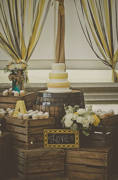 A rustic dessert display we love! Check out those roses! {Patrick Hadley Photography}