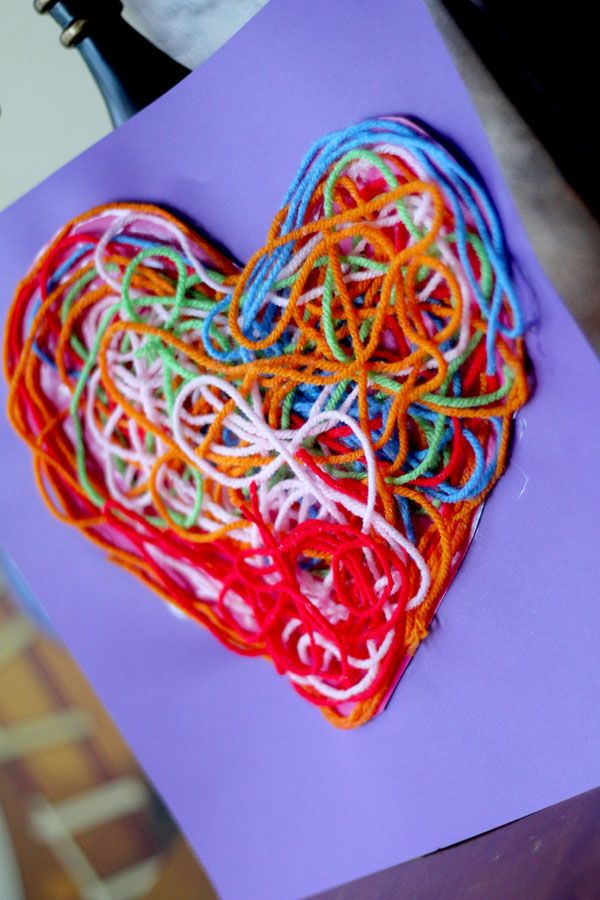 A yarn heart craft with a lot of texture for a Valentine's display.