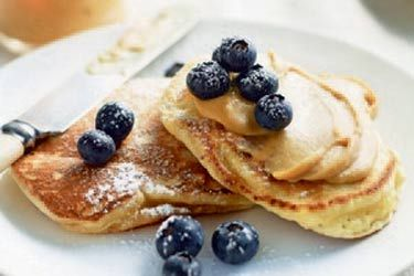 Lemon ricotta cakes with caramel butter and blueberries