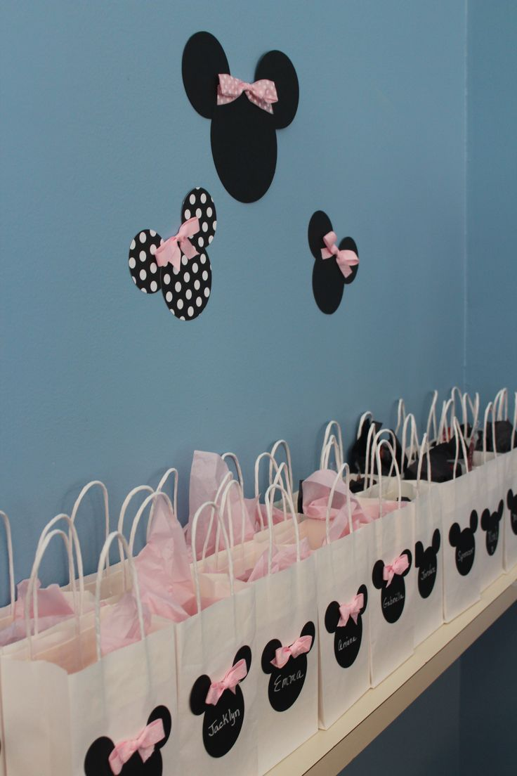 Minnie Mouse 1st Birthday for my niece. Favor bags with Minnie' and Mickey's silhouettes. *easily made with cardstock and ribbon
