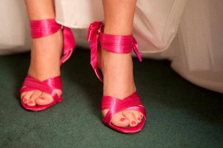 Vibrant fuscia sandals. Made of satin, with the crisscross straps and decorative bow at heel.