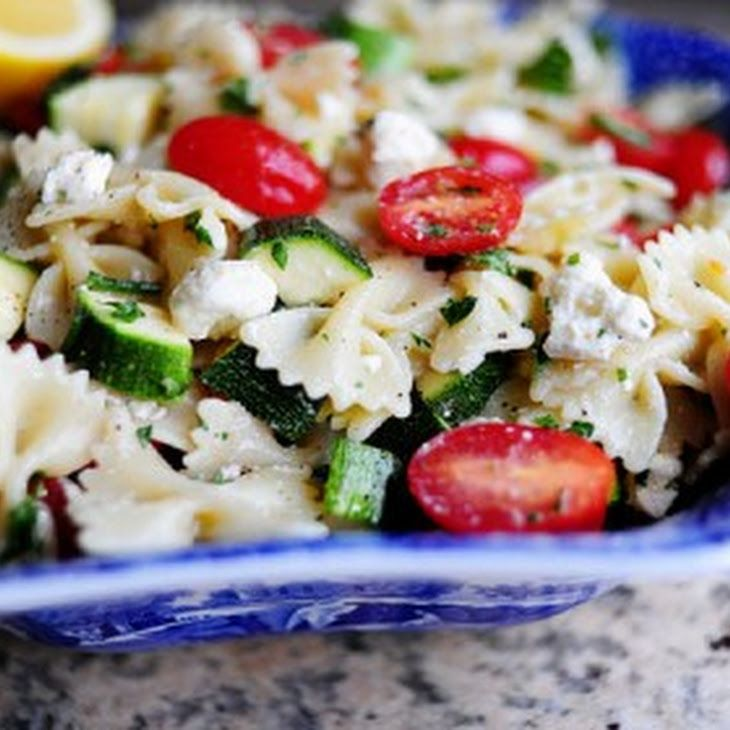 Pasta Salad with Tomatoes, Zucchini, and Feta Recipe Side Dishes, Salads with bow-tie pasta, extra-virgin olive oil, lemon, salt, ground black pepper, zucchini, grape tomatoes, fresh parsley, feta cheese crumbles