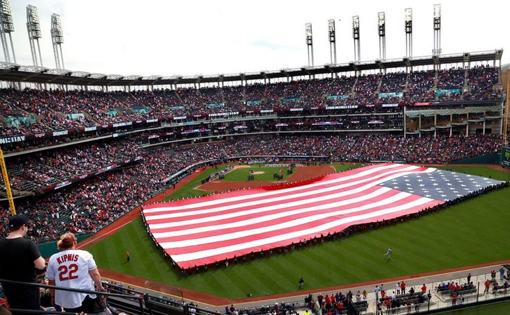 Progressive Insurance employees unfurled the flag at the Cleveland Indians home opener against the Chicago White Sox, Tuesday, April 11, 2017.  (Lynn Ischay/The Plain Dealer)