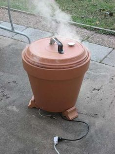 How To Make A Terra Cotta Pot Meat Smoker  - http://www.ecosnippets.com/diy/how-to-make-a-terra-cotta-meat-smoker/