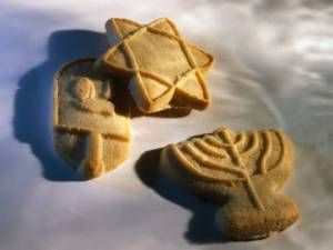 Hanukkah Sugar Cookies | Here's a fun and easy recipe for Hanukkah Sugar Cookies that can be made with the help of your children. They'll love making the icing and decorating the cookies. A great way to get your kids involved in the holiday and also learn a little about baking cookies.