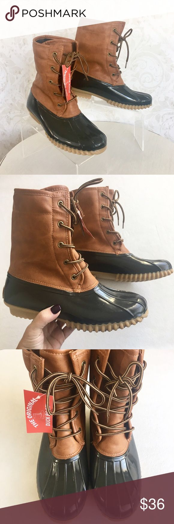 The Original Duck Boot all-weather boots Protect yourself from the elements in style! Super grippy rubbery outsole, waterproof brown upper, faux leather tan boot shaft. Lace up for perfect fit. NWT; never even tried on. In original box. The Original Duck Boot Shoes Winter & Rain Boots
