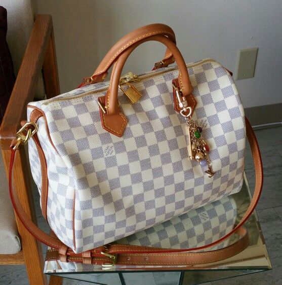 how to tell whether a louis vuitton bag is real