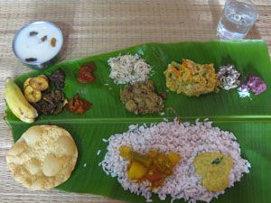 Kerala Sadya : Sadya means banquet in Malayalam. It is a typical feast of the people of Kerala. Sadya is traditionally a vegetarian meal served on a banana leaf. A Sadya can have about 24-28 dishes served as a single course.The dishes are served on specific places on the banana leaf in specific order. The sadhya is usually served for lunch on special occasions like festivities, birthdays and weddings.