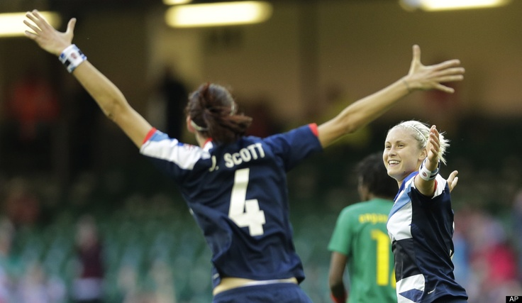 Britain's Stephanie Houghton, right, celebrates after scoring with her teammate Jill Scott, during the women's group E soccer match between Britain and Cameroon, at the Millennium stadium in Cardiff, Wales, at the 2012 London Summer Olympics, Saturday, July 28, 2012.
