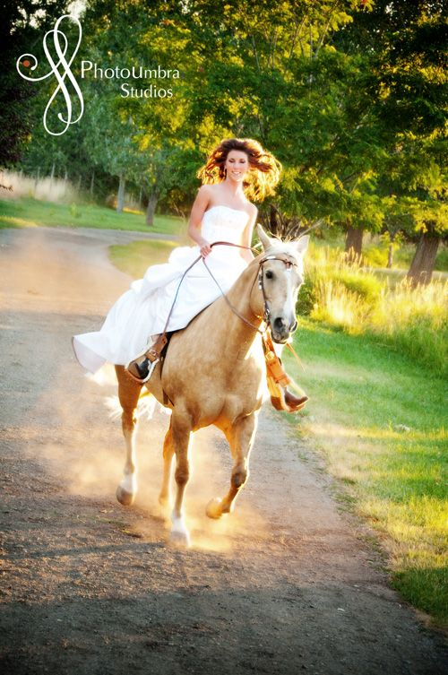 i WILL have pictures on a horse in my wedding dress. haha