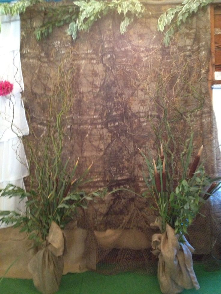 The Groom's side of the Table was decorated in a Duck Hunting theme with Cattails, Grasses, Camoflauge and Burlap.