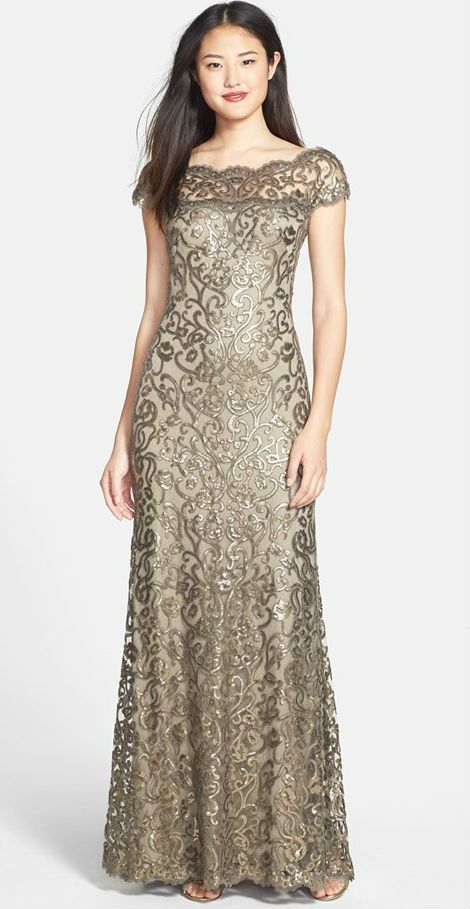 Such a stylish dress for the mother-of-the-bride or mother-of-the-groom! Golden lace dress with illusion neckline and sequins.