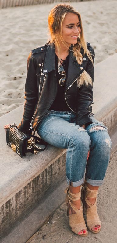 Janni Deler + classic leather biker jacket + retro fifties style + perfect for an edgy and alternative look + Ripped jeans + essential    Brands not specified.