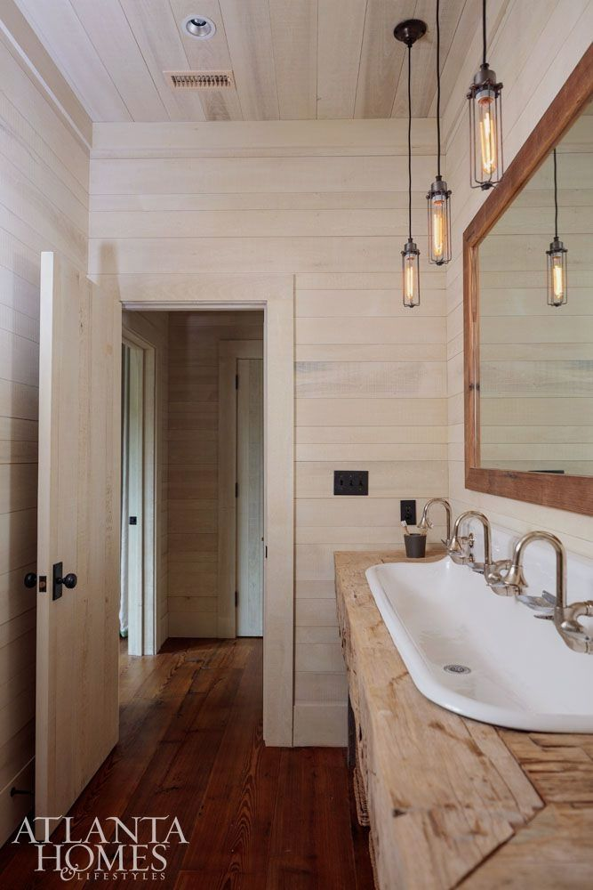 This Hunting Lodge Is Just The Kind Of Place We Want To Curl Up By The Fire Make S Mores And Wait Lake House Bathroom Rustic Bathroom Lighting Cabin Bathrooms