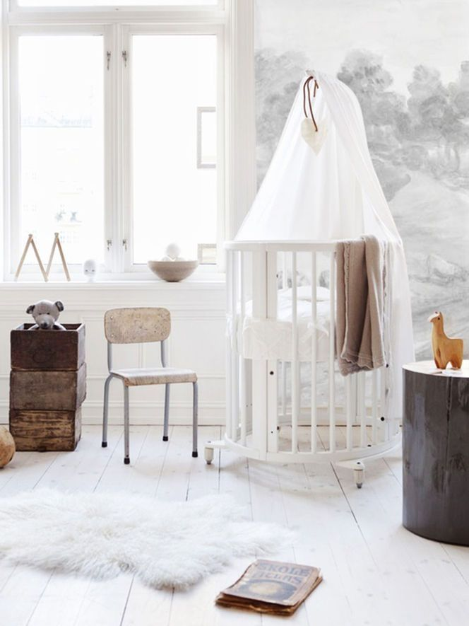 This nursery is full of vintage love... and so peaceful and bright!