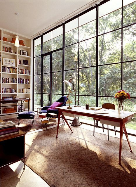 Modeled after steel factory panels, the floor-to-ceiling windows in this Hamptons house lend a note of industrialism which is carefully balanced by an extraordinary mix of mid-century furniture pieces by Eero Saarinen and Jean Prouvé.