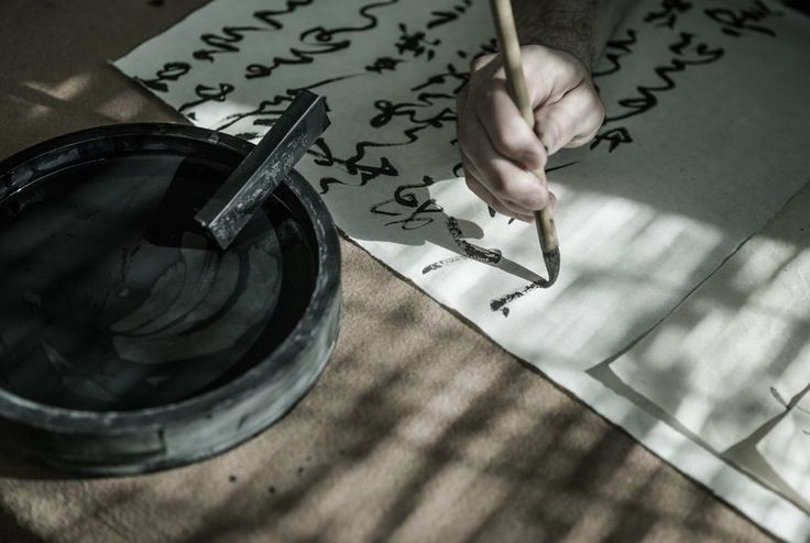 He dipped the brush into the black paint. He exhaled slowly to steady his shaking hand. He was going to get this calligraphy right. He slowly let the brush touch the paper and began to paint...