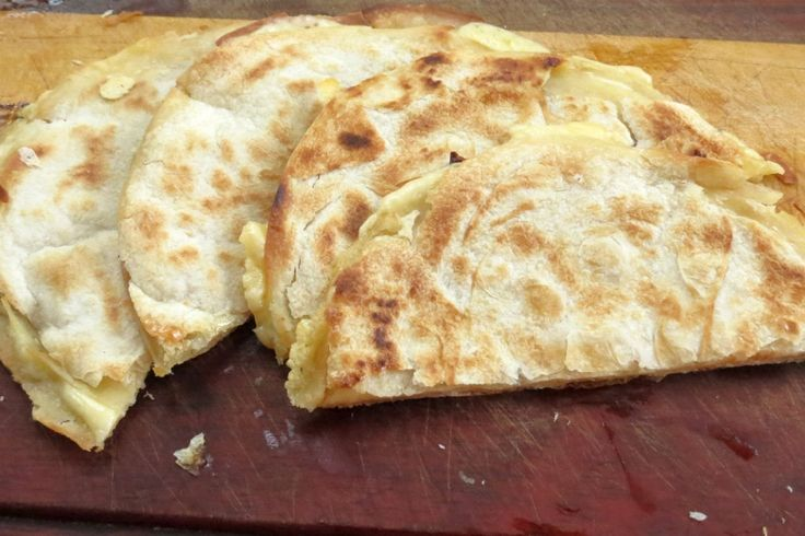 How to make quesadillas in the oven. Super simple and best way to make them. No fuss for crispy tortillas filled with melted cheese. Delicious.