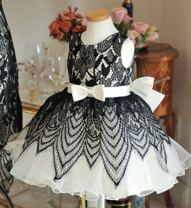 Lace Flower Dress--Made To Order - High Quality Beautiful Round Neckline Sleeveless Tea - Knee Length Big Bow Back Baby Infant Toddler Little & Big Girl Lace Flower Dress. Perfect dress for your little flower girl, birthday, baptism, communion or any occasion. Available from newborn until 15 years old. Material: Cotton, tulle mesh, satin. Color: Black & White. Please do compare your  little girl measurements with our size chart.