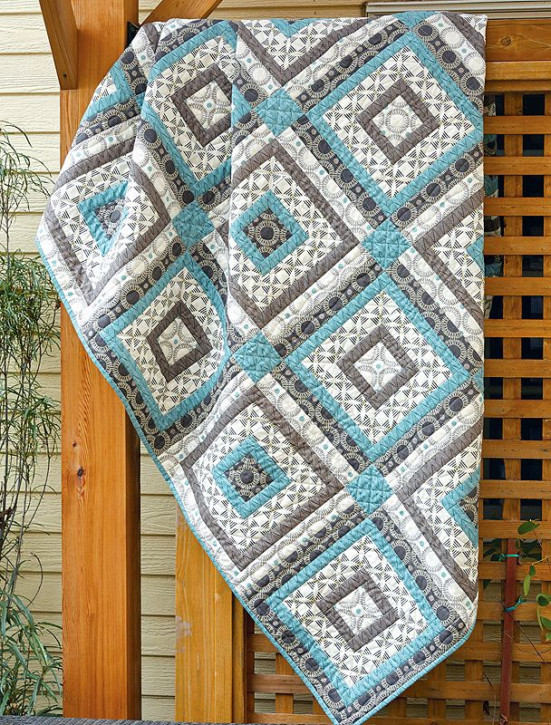 Cool, clean, and so urban. This easy-as-pie spin on classic log cabin quilts is a great choice for a new apartment.