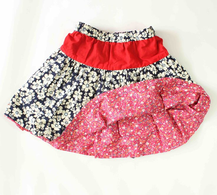 Reversible Girls Skirt (Floral/Pink): This gorgeous reversible skirt can be worn two ways making it double the fun and if you have a messy little one simply flip it over and you have a clean outfit and new look.   It has an elastic waistband making it easy to put on. It is made with lightweight cotton giving your little girl the perfect twirl as well as making it easy to clean.
