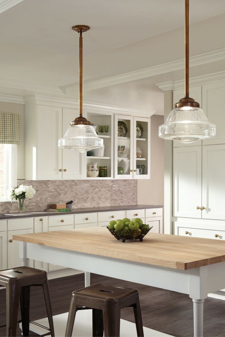 the traditional schoolhouse lighting fixture has been updated in the alcott pendant light collection by feiss