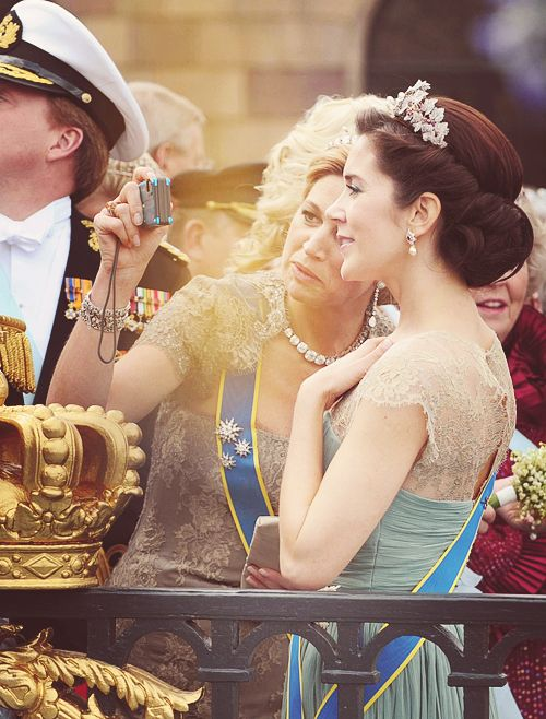 Princess Máxima of the Netherlands snapping a photo of Crown Princess Mary of Denmark and herself at Crown Princess Victoria of Sweden's wedding.