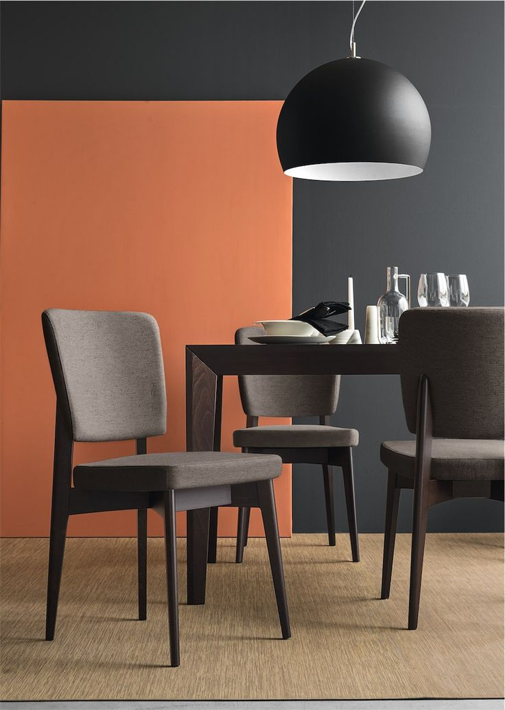 Connubia Calligaris | Escudo Dining Chair | A comfortable chair with a cushioned seat and back rest.