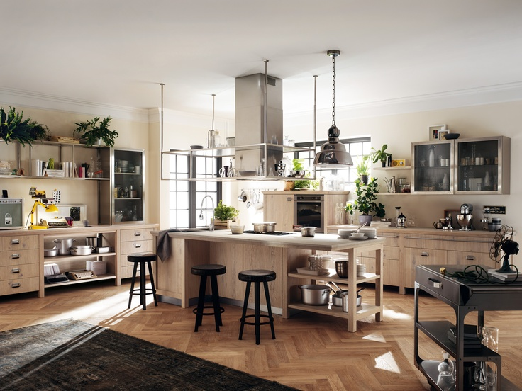 Diesel Social Kitchen design by Diesel. Let's live together! The kitchen's key feature is the central counter, the real fulcrum of the room's social life. Around it: storage units, open-fronted units and vintage glass-door cabinets represent the emblem of industrial design. #DieselSocialKitchen #Diesel #Scavolini #Kitchen