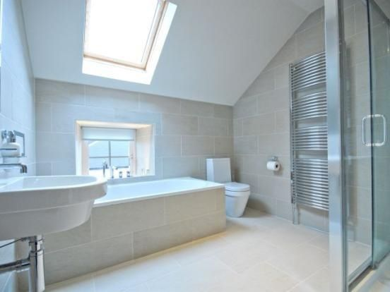 Wonderful Pale Bathroom With Sloping Ceiling And Skylight Barnsley UK Stock