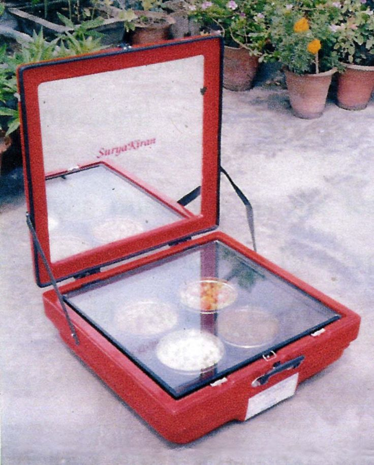 solar oven- out of a used briefcase or suitcase. Glue a mirror inside lid. Set a glass across top